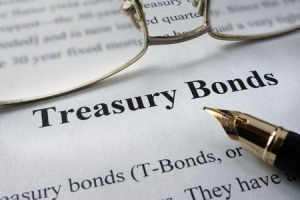 60526905 - page of newspaper with words treasury bonds. trading concept.